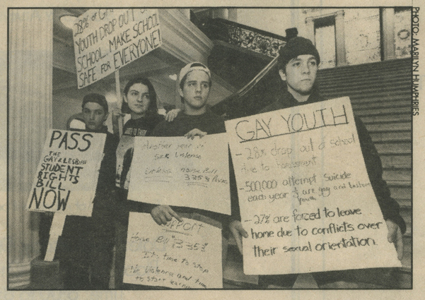 """Bay Windows, December 9-15, 1993, photo Marilyn Humphries """"Rallies like this one held by gay and lesbian students and their supporters on Nov. 30 are credited with spurring the legislature's final approval a bill to protect the rights of lesbian and gay public school students in Massachusetts. Pictured are, from left to right, [Marsian] De Lellis, Khadijah [Silver], Julien Ginsberg, Josh Dreyfus"""