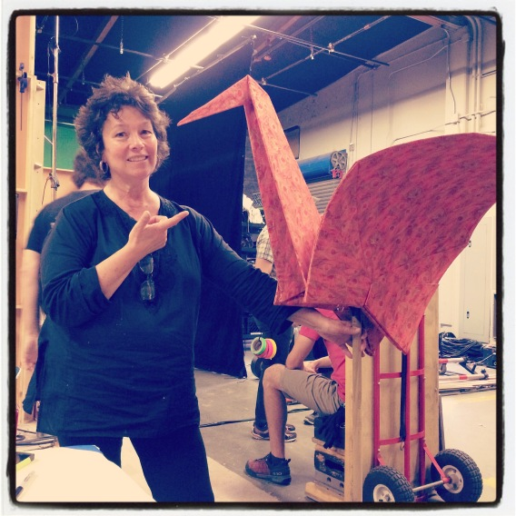 Christine Papalexis with an origami crane she built for Dave Made A Maze, 2015